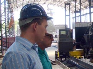 ShipConstructor Software's Deputy CEO Darren Larkins inspects an ESAB NC-Cutting Machine