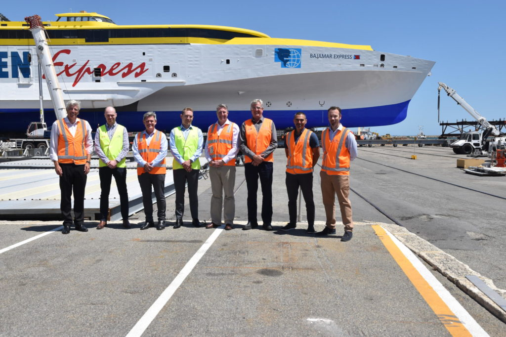 SSI and Austal executives in front of trimaran Bajamar Express