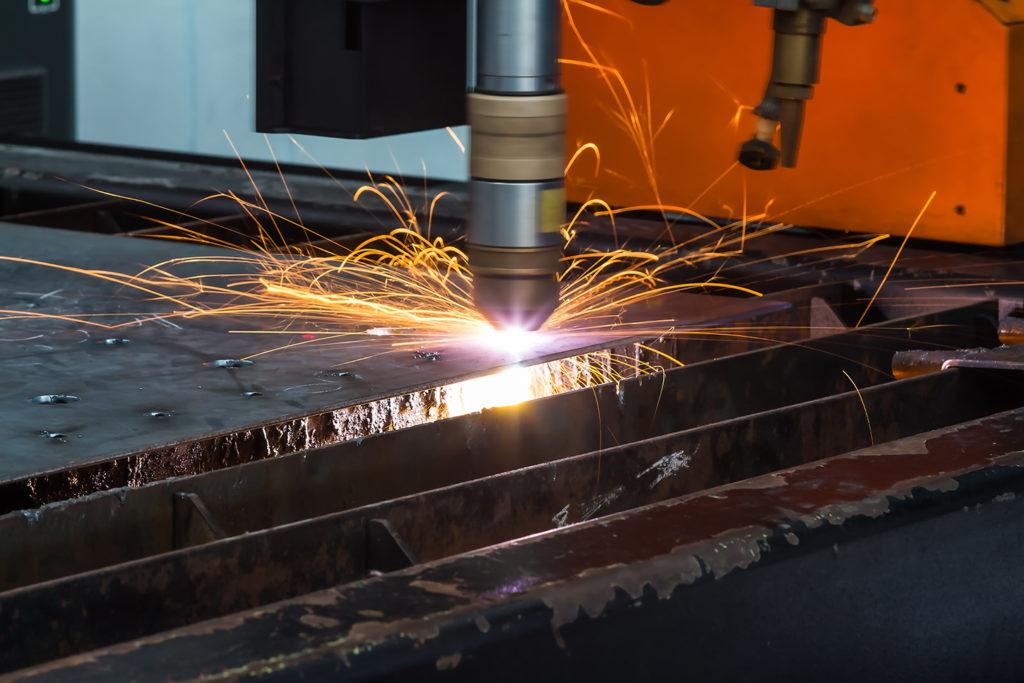A CNC machine cutting steel