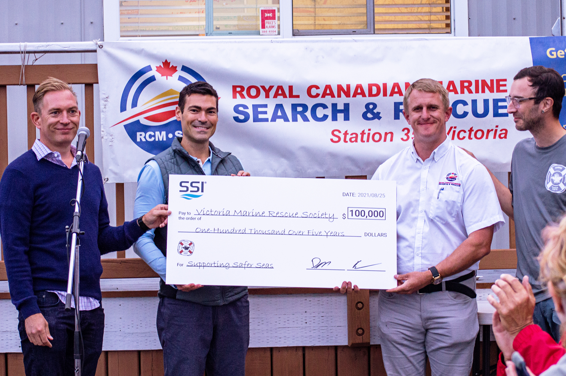 SSI co-CEOs hand big check  for 100,000 to VMRS and RCMSAR Station 35 lead